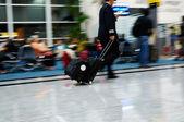 People walking at airport (motion blur) — Stock Photo