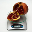 Stock Photo: Average weight of pomegranate