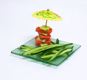 Imagination with decorative umbrellas and vegetables. — Stock Photo