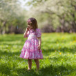 Stock Photo: Little girl in spring garden