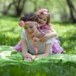 Girl and woman in the spring garden — Stock Photo