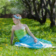 The young woman in spring meadow — Stock Photo