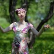 The young woman in spring garden — Stock Photo