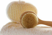 Towel with body brush — Stock Photo