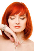 Beautiful redhead woman with necklace and bracelet — Stock Photo