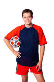 Smiling footballer with football — Stock Photo