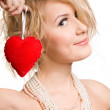 Blonde beautiful girl holding big red heart — Stock Photo