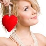 Blonde beautiful girl holding big red heart — Stock Photo