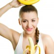 Beautiful girl with two bananas — Stock Photo