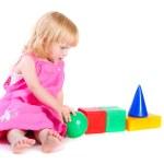 bebé vestido rosa jugando con bloques brillantes — Foto de Stock