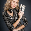 Beautiful blonde girl holding little black and white purse — Stock Photo #19583159