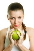 Beautiful young woman with green apple — Stock Photo