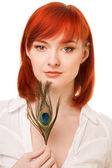 Beautiful redhead woman with peacock feather — Stock Photo