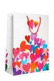 Bolsa de papel blanca con muchos corazones — Foto de Stock
