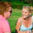 Blonde funny girl with red head cute boy in the park — Stock Photo #19889625