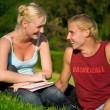 Blonde funny girl with blonde cute boy in the park laughting together — Stock Photo