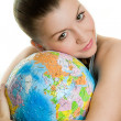 Girl with a globe of the world over white background — Stock Photo