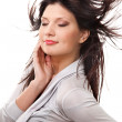 Attractive smiling woman with beautiful windy hair — Stock Photo #19889875