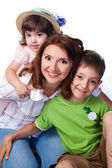 Happy family with mother and children — Stock Photo