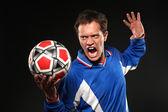 Joueur de football crier au bal — Photo