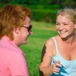 Blonde funny girl with red head cute boy in the park — Stock Photo #20315183