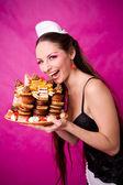 Smiling girl holding cake — Stock Photo