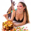 Smiling girl with sweets and candies - Stock Photo