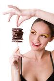 Girl holding chocolate — Stock Photo