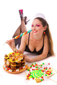 Smiling girl with sweets and candies — Stock Photo