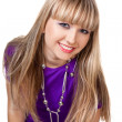 Stock Photo: Beautiful girl in purple clothes with silver necklace