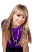 Beautiful girl in purple clothes with silver necklace — Stock Photo