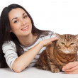 Beautiful smiling brunette girl and her ginger cat over white ba — Stock Photo #23547281