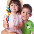 Portrait of a brother and sister  with candy — Stock Photo