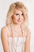 Beautiful blonde girl with beads — Stock Photo