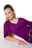 Beautiful girl lieing in purple dress — Stock Photo