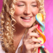 Blonde girl holding lollipop — Stock Photo