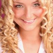 Stock Photo: Smiling beautiful blonde girl