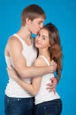 Young love couple holding and kissing each other in the studio — Stock Photo