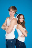 Young love couple wearing headphones, listening music in the stu — Stock Photo