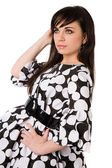 Beautiful brunette in black and white dress — Stock Photo