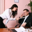 Stock Photo: Businessman looking at his secretary in office