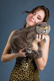 Beautiful brunette smiling woman with grey cat — Stock Photo