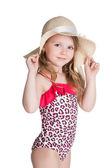 Little blonde happy girl in pink swimsuit holding hat — Stock Photo