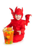 Little boy in red devil costume sitting near big bucket — Stock Photo