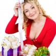 Stock Photo: Beautiful smiling blonde girl with presents