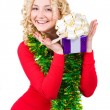 Beautiful blonde girl with present and decoration — Stock Photo