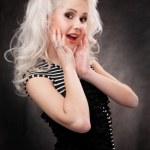 Studio shot of a young, beautiful, blonde woman in black dress — Stock Photo