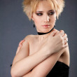 Beautiful young blonde girl in black dres — Stock Photo #34832833