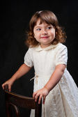 Cute little girl with curly hair — Stock Photo