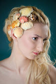 Beautiful girl with little shells in her hair-do — Stock Photo